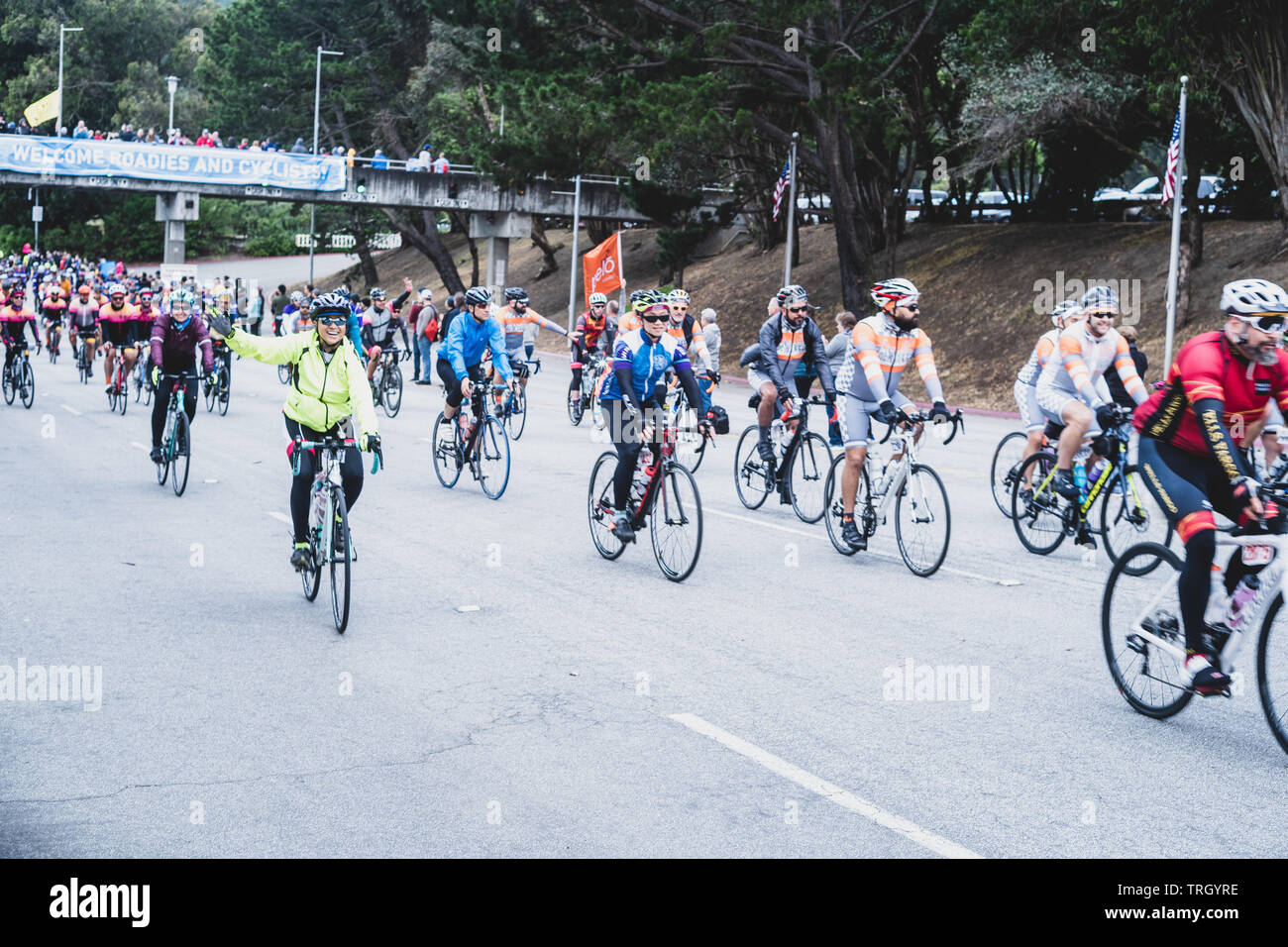 San Francisco, USA. 2nd June, 2019. Cyclists with fans cheering them on as they leave the Cow Palace at the start of the AIDS/Lifecycle. Stock Photo