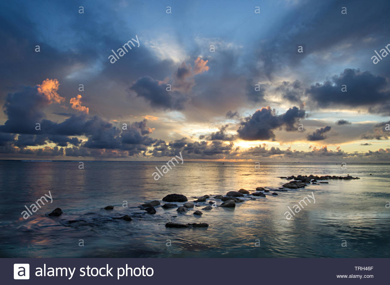 Twilight over Bel Ombre in Mauritus where reflections on Indian Ocean created a heavenly atmosphere with the most colorful cloudscape - Stock Image
