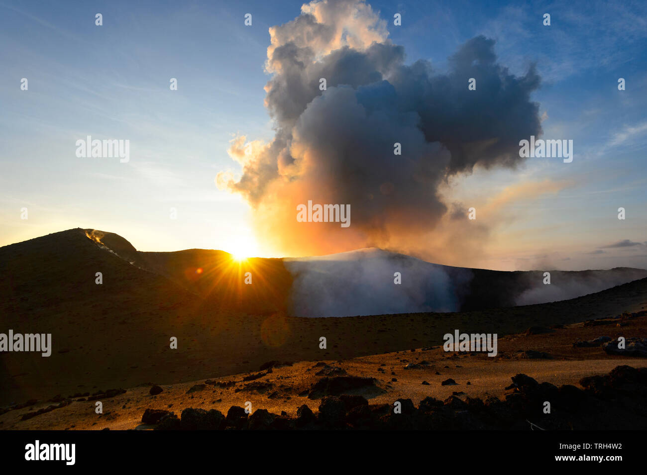 Erupting Mt Yasur Volcano at sunset, Tanna Island, Vanuatu - Stock Image