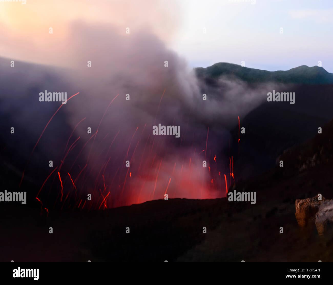 Glowing Lava, fumaroles, hot gases and sparks at erupting Mt Yasur Volcano, Tanna Island, Vanuatu - Stock Image