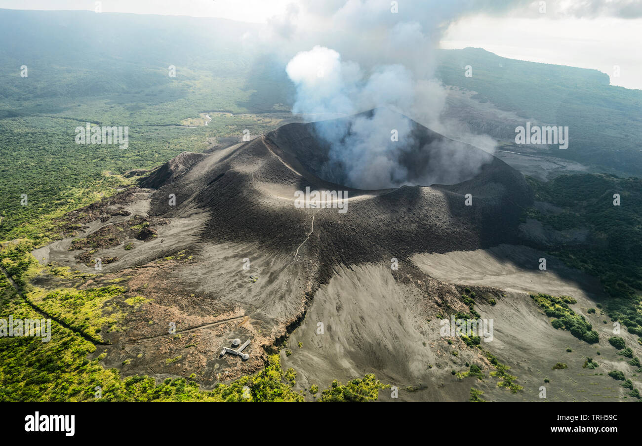 Aerial view of smoking Mt Yasur Volcano which has been erupting for hundreds of years, Tanna Island, Vanuatu - Stock Image