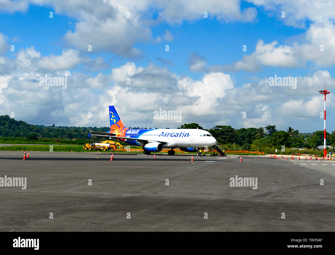 An Airbus A320-200 from Aircalin, the New Caledonia airline, on the apron at Port Vila Airport, Vanuatu - Stock Image
