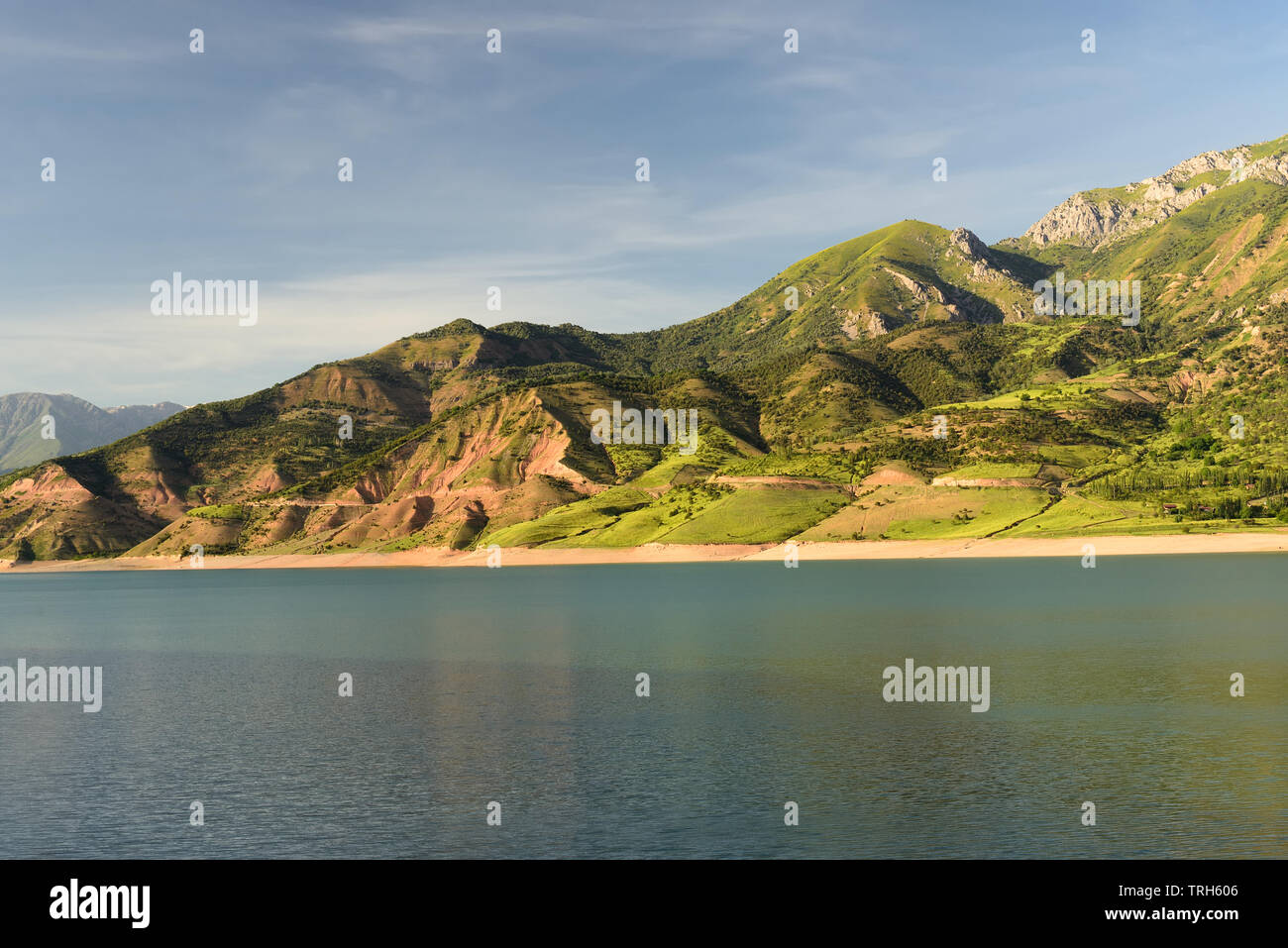 Landscape of the lake and the mountains in Ugam - Chatkal National Park, holiday destination  of hiking and adventure-sport located near the Tashkent, Stock Photo