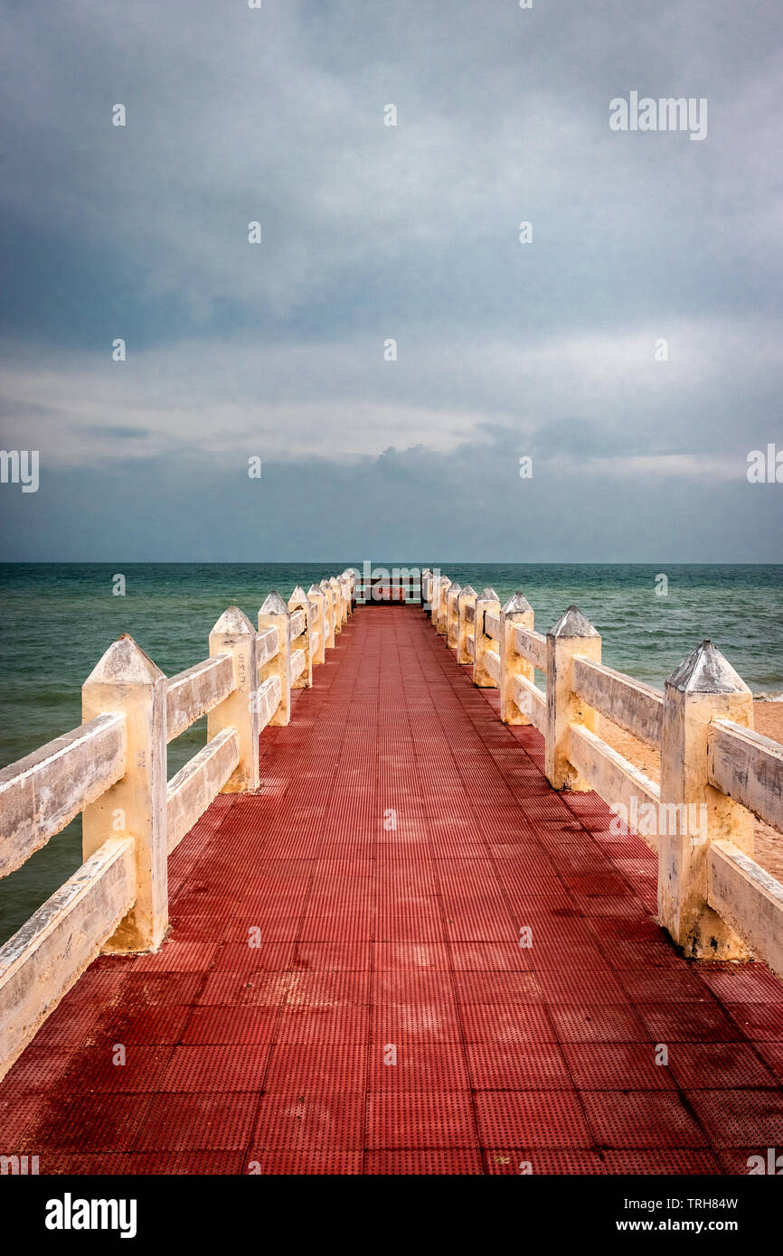 Red color leading line towards sweet pond near sea shore at sita kund rameswaram india. - Stock Image