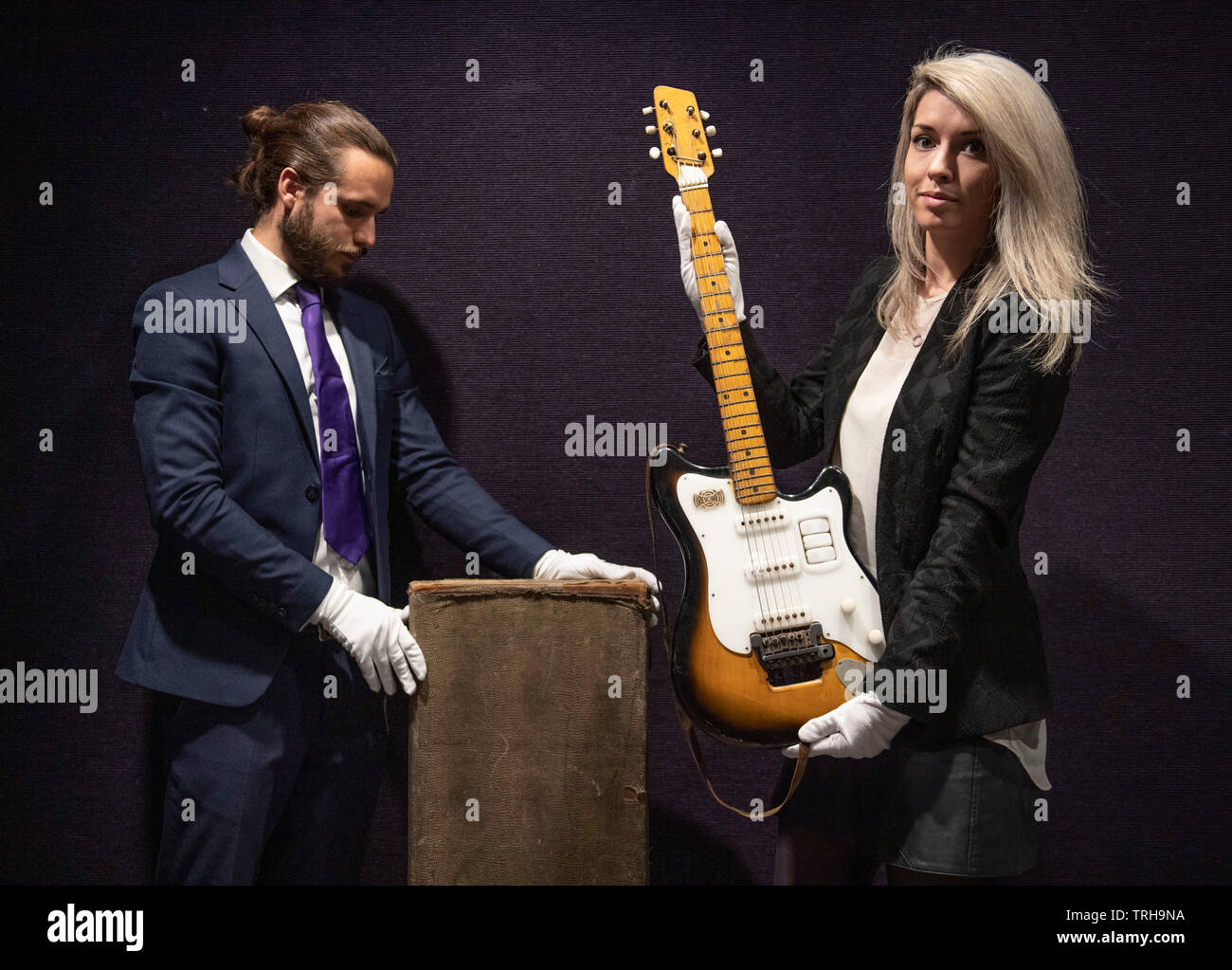 Bonhams, London, UK. 6th June 2019. Bonhams Entertainment Memorabilia sale preview. George Harrison's Futurama electric guitar, c 1958, on display at Bonhams Entertainment Memorabilia sale preview Knightsbridge for sale on 12th June. Estimate £200,000-300,000. This historically important guitar, which comes in its original case (pictured) embellished with Hamburg stickers, has never been seen on the market before; it has impeccable provenance and is extremely well-documented. Credit: Malcolm Park/Alamy Live News. - Stock Image