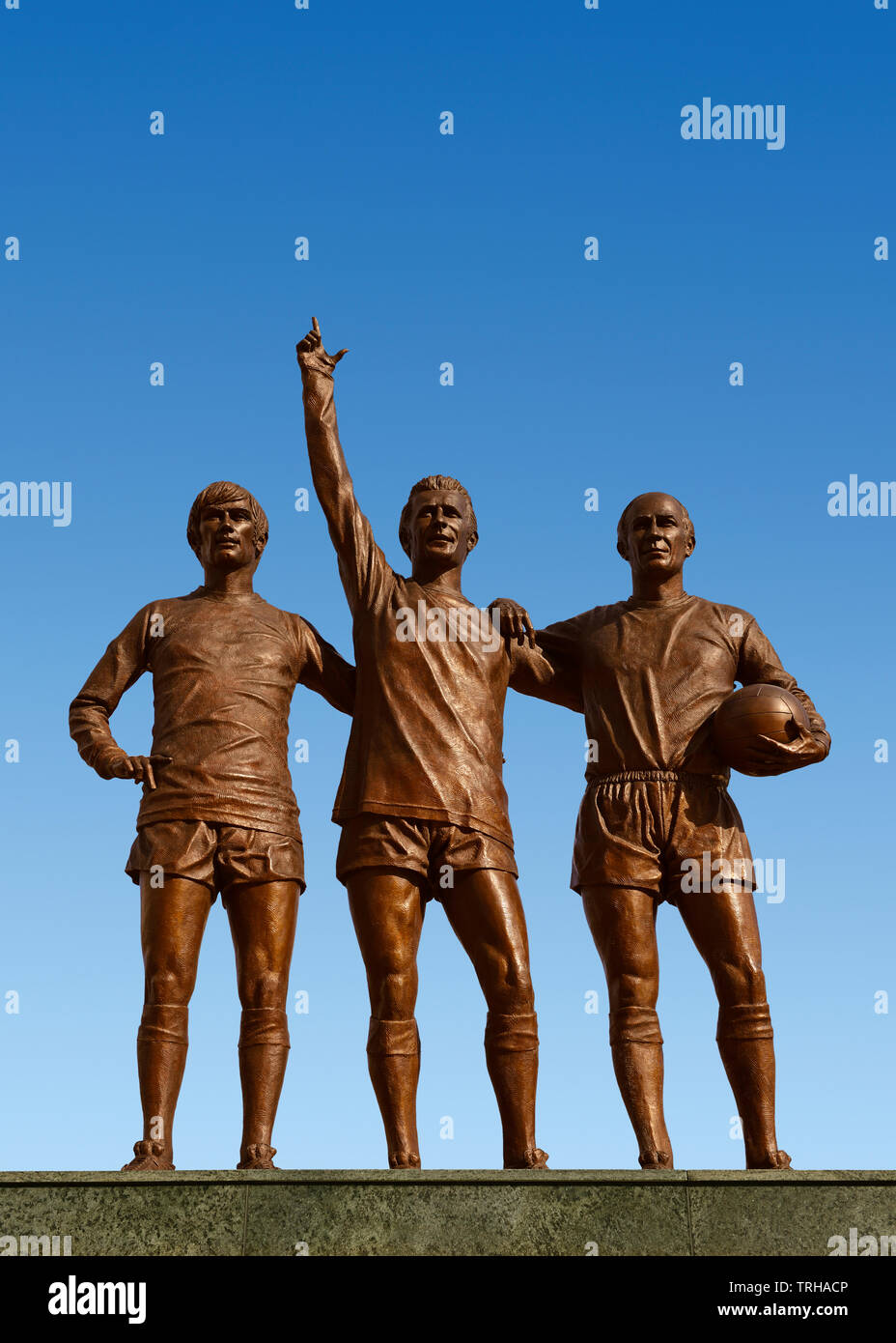 Holy Trinity Statue Outside the Manchester United Stadium, Old Trafford, Manchester, United Kingdom - Stock Image