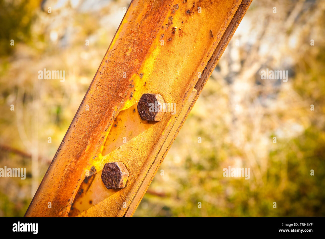 Old rusty iron structure with bolted metal profiles - Stock Image