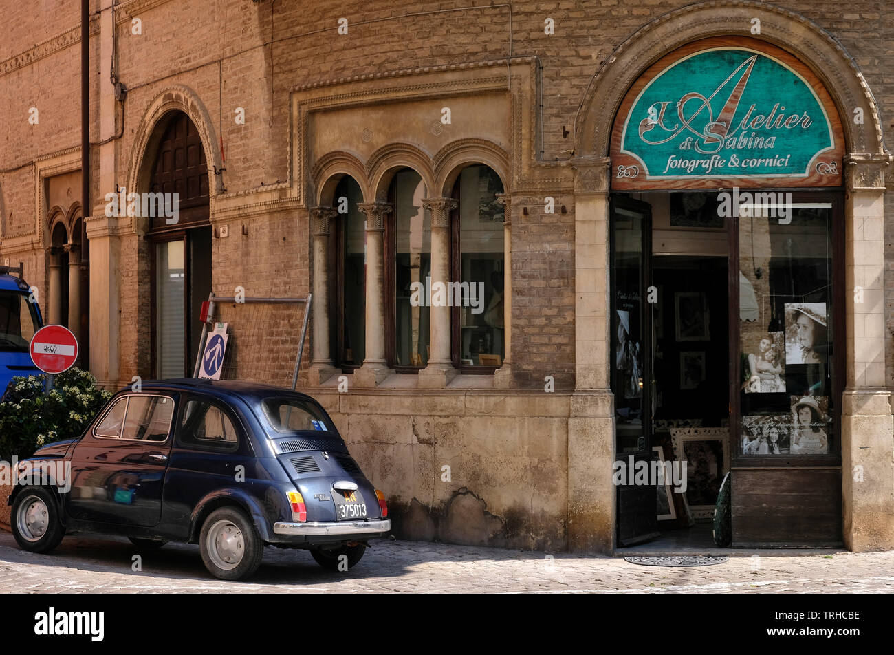 Old Fiat 500 next to a photo studio in the coastal town of Fano, Marche region, Italy. Stock Photo