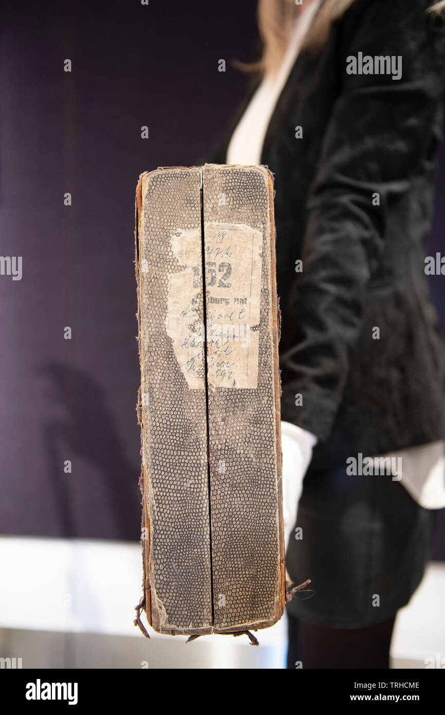 Bonhams, London, UK. 6th June 2019. George Harrison's Futurama electric guitar, c 1958, on display at Bonhams Entertainment Memorabilia sale preview Knightsbridge for sale on 12th June. Estimate £200,000-300,000. This historically important guitar comes in its original case (pictured) embellished with Hamburg stickers, has never been seen on the market before; it has impeccable provenance and is extremely well-documented. Credit: Malcolm Park/Alamy Live News. - Stock Image