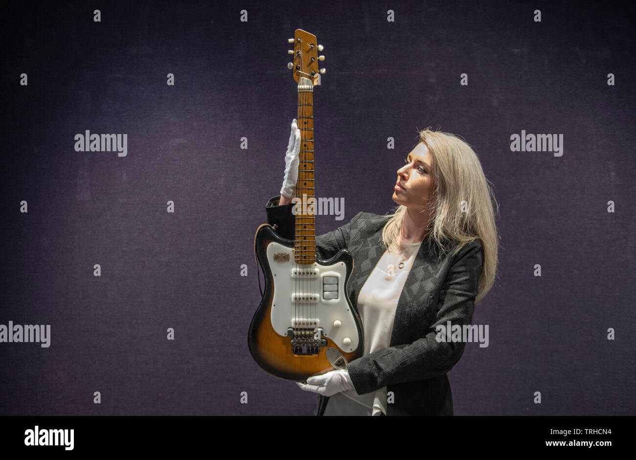 Bonhams, London, UK. 6th June 2019. George Harrison's Futurama electric guitar, c 1958, on display at Bonhams Entertainment Memorabilia sale preview Knightsbridge for sale on 12th June. Estimate £200,000-300,000. This historically important guitar, which comes in its original case embellished with Hamburg stickers, has never been seen on the market before; it has impeccable provenance and is extremely well-documented. Credit: Malcolm Park/Alamy Live News. - Stock Image