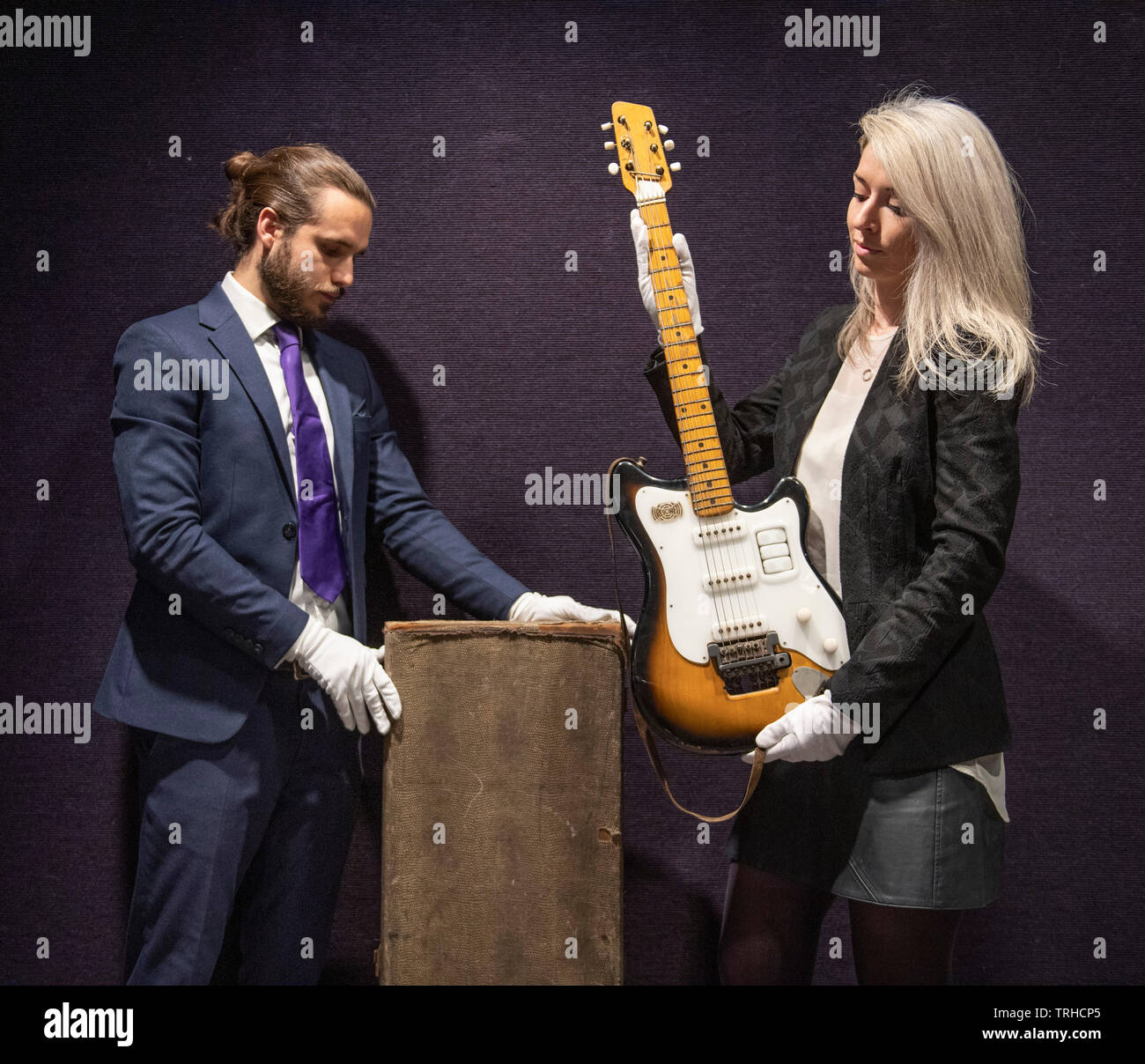 Bonhams, London, UK. 6th June 2019. George Harrison's Futurama electric guitar, c 1958, on display at Bonhams Entertainment Memorabilia sale preview Knightsbridge for sale on 12th June. Estimate £200,000-300,000. This historically important guitar, which comes in its original case (pictured) embellished with Hamburg stickers, has never been seen on the market before; it has impeccable provenance and is extremely well-documented. Credit: Malcolm Park/Alamy Live News. - Stock Image
