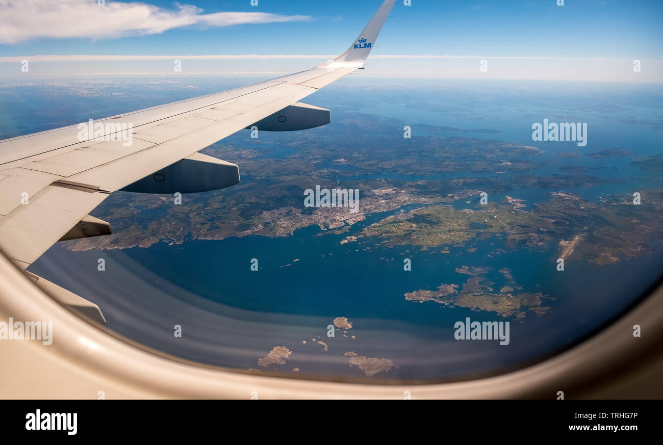 Approaching the Bergen airport, looking out of aircraft windows over the wings, on the fjords of Bergen, Blomsterdalen, Kokstad, Hordaland, Norway, Sc Stock Photo
