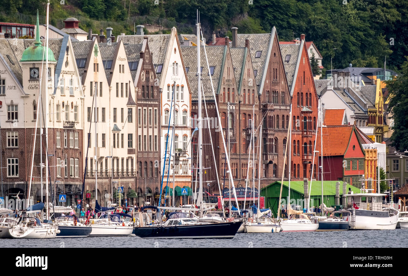 Sailboats in front of a photorealistic row of houses in the Hanseatic quarter of Bryggen near Bergen havn, Hordaland, Norway, Scandinavia, Europe, Ber - Stock Image