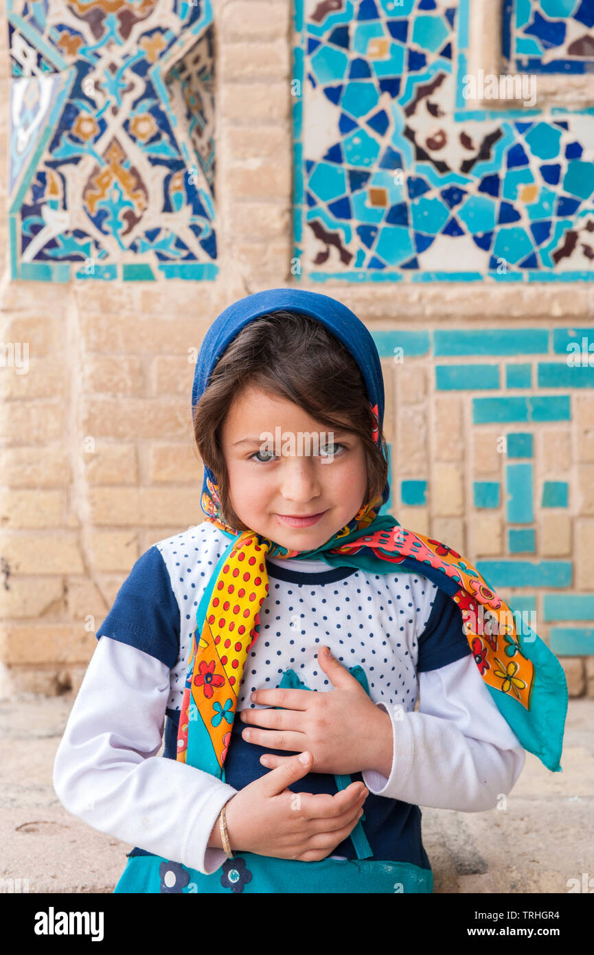 A girl at Friday morning prayer at Jame Historical Mosque in the village of Varzaneh, Iran. - Stock Image