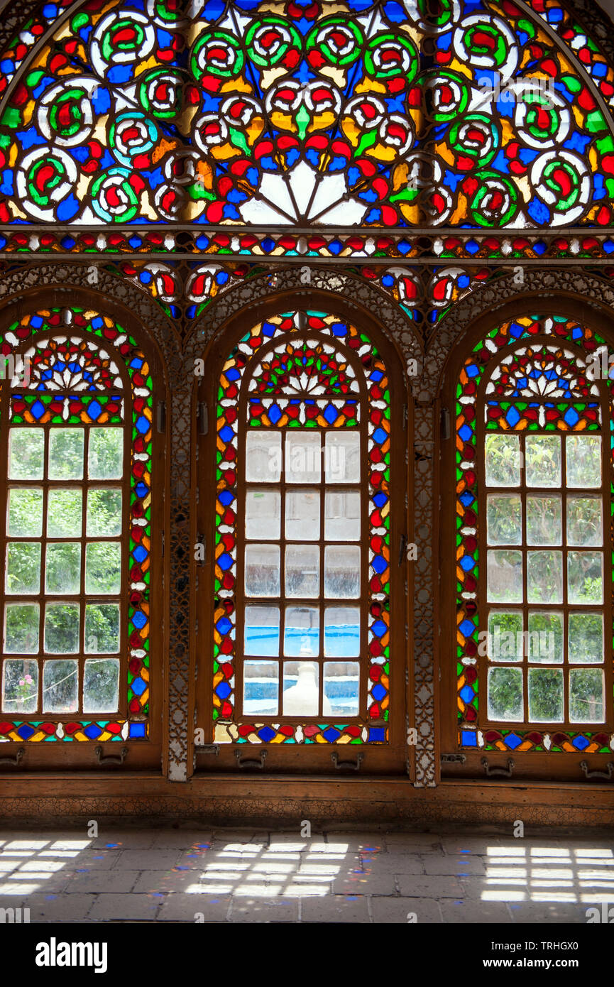 A room with stained glass windows inside the water museum, housed in a former merchant's house, in Yazd, Iran. - Stock Image