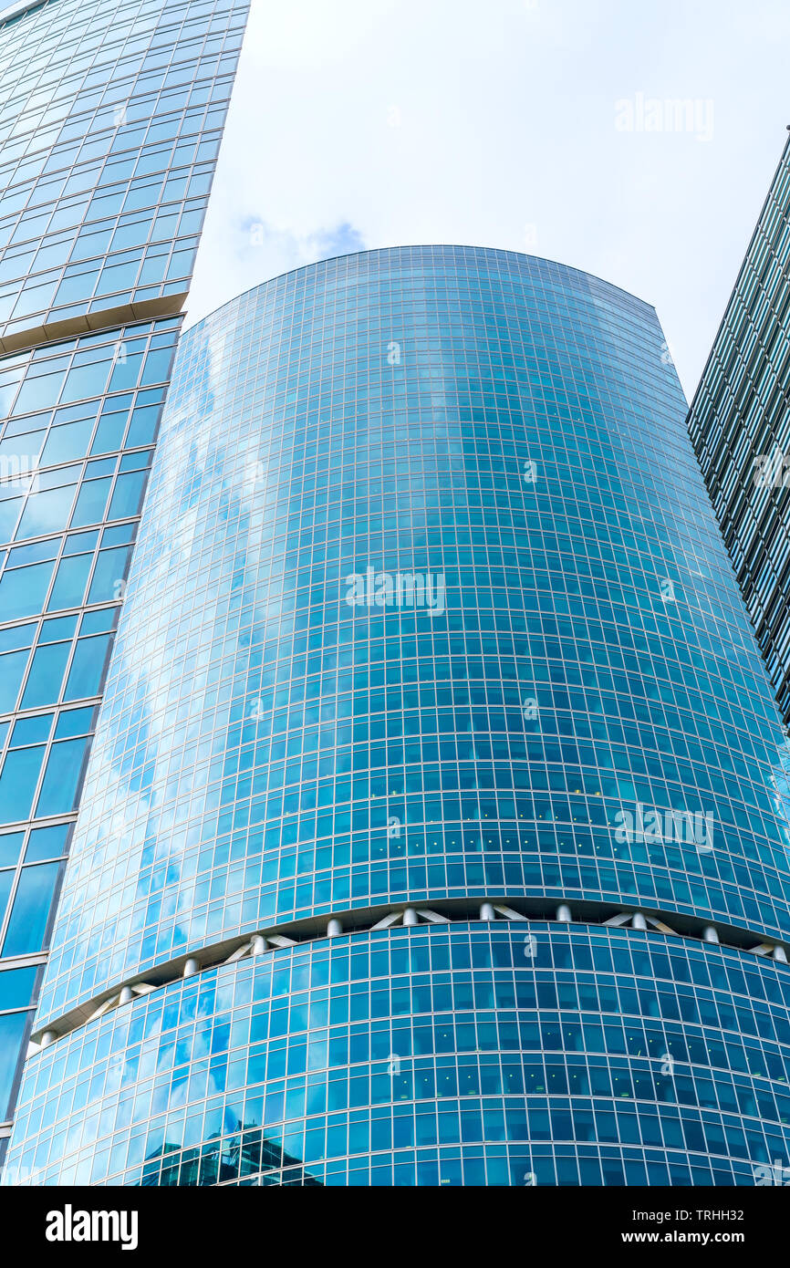 fragment of contemporary architecture, walls made of glass and concrete. Glass curtain wall of modern office building Stock Photo