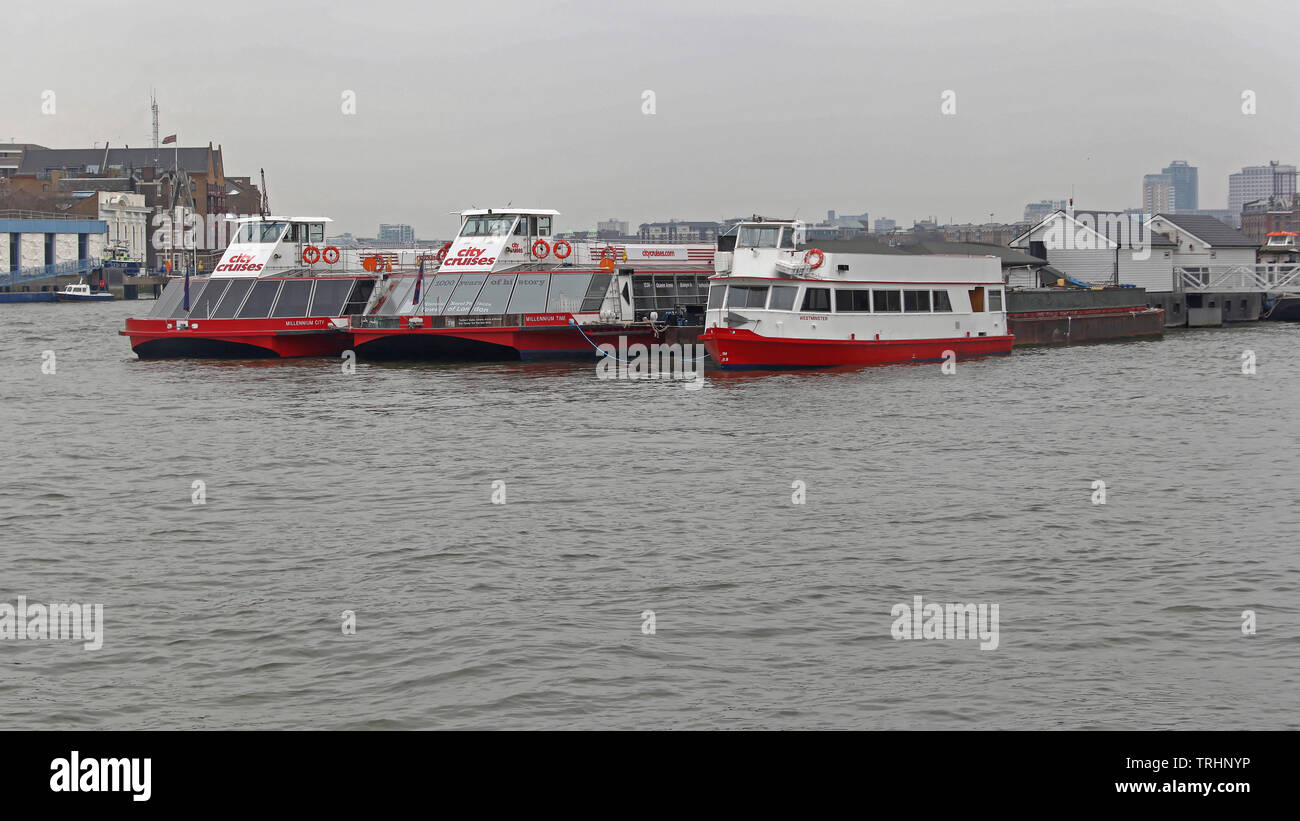 London, United Kingdom - January 25, 2013: City Cruises Tourists Boats Moored at Thames River in London, UK. - Stock Image