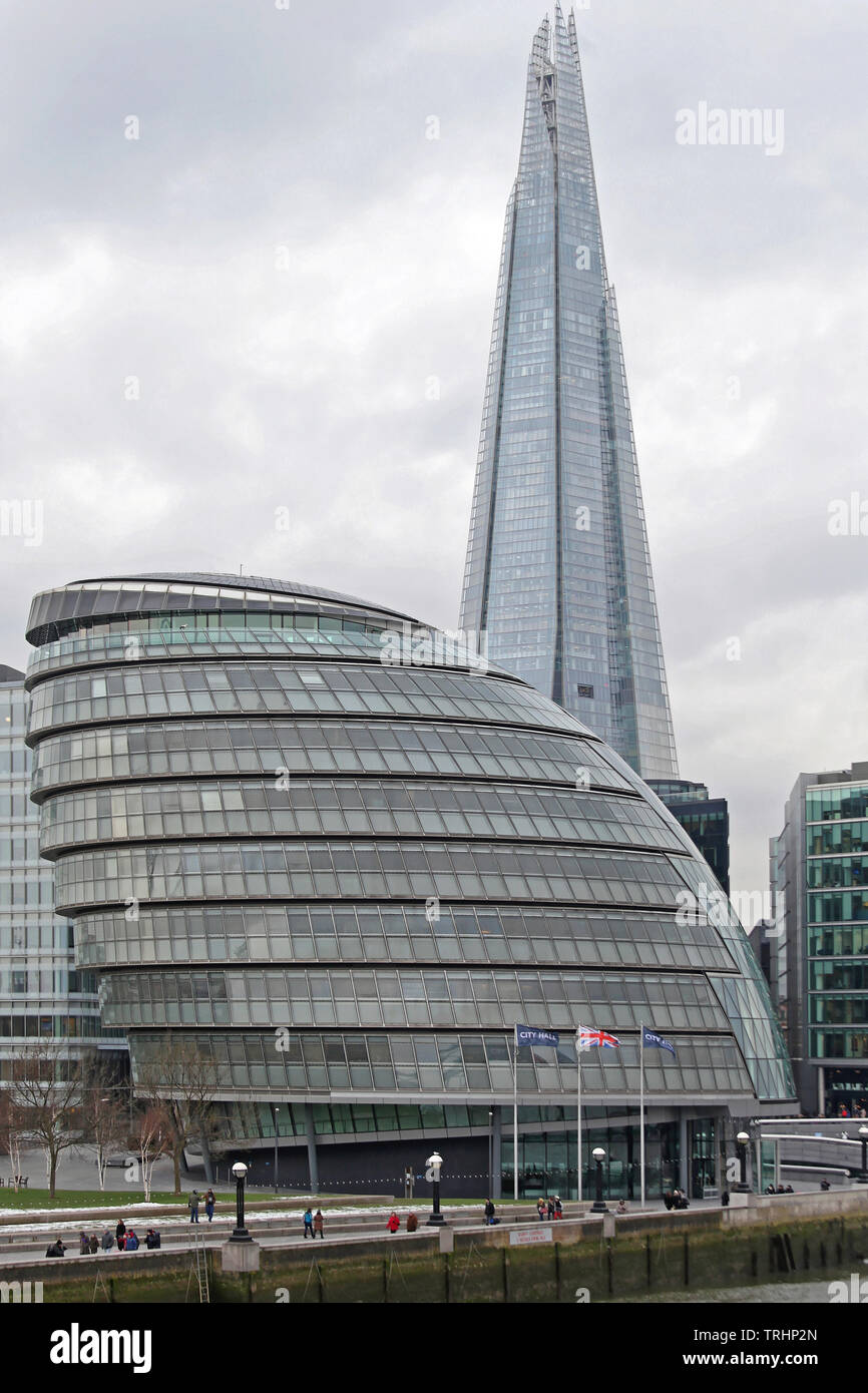 London, United Kingdom - January 25, 2013: City Hall Building and The Shard Skyscraper at Southwark in London, UK. - Stock Image