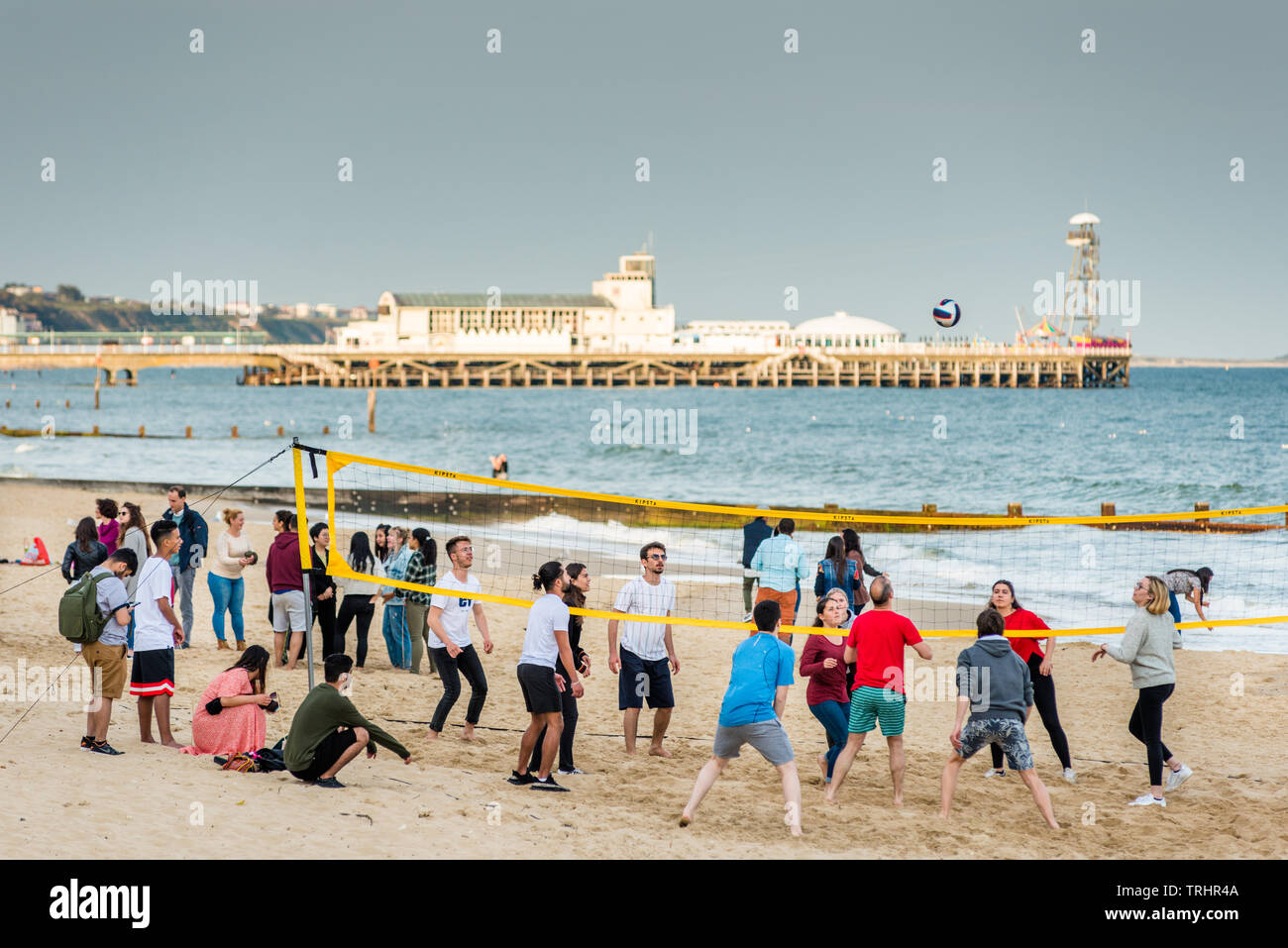 Volleyball on Bournemouth beach with the Pier to the rear. Dorset. England, UK. Stock Photo