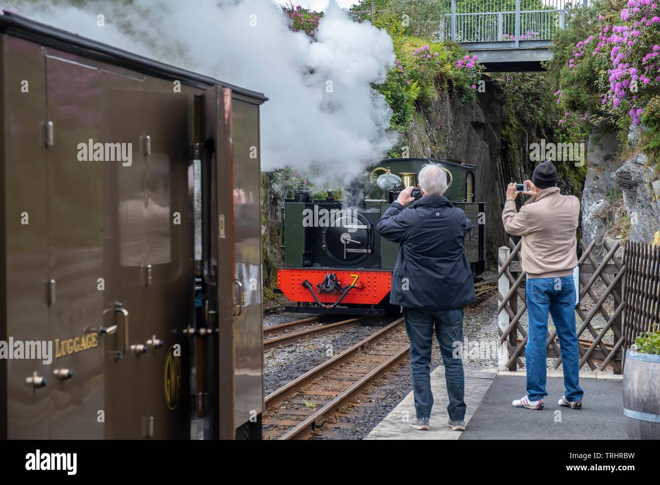 Tourists at platform, Vale of Rheidol Steam Railway, Devil's Bridge Station, Wales - Stock Image