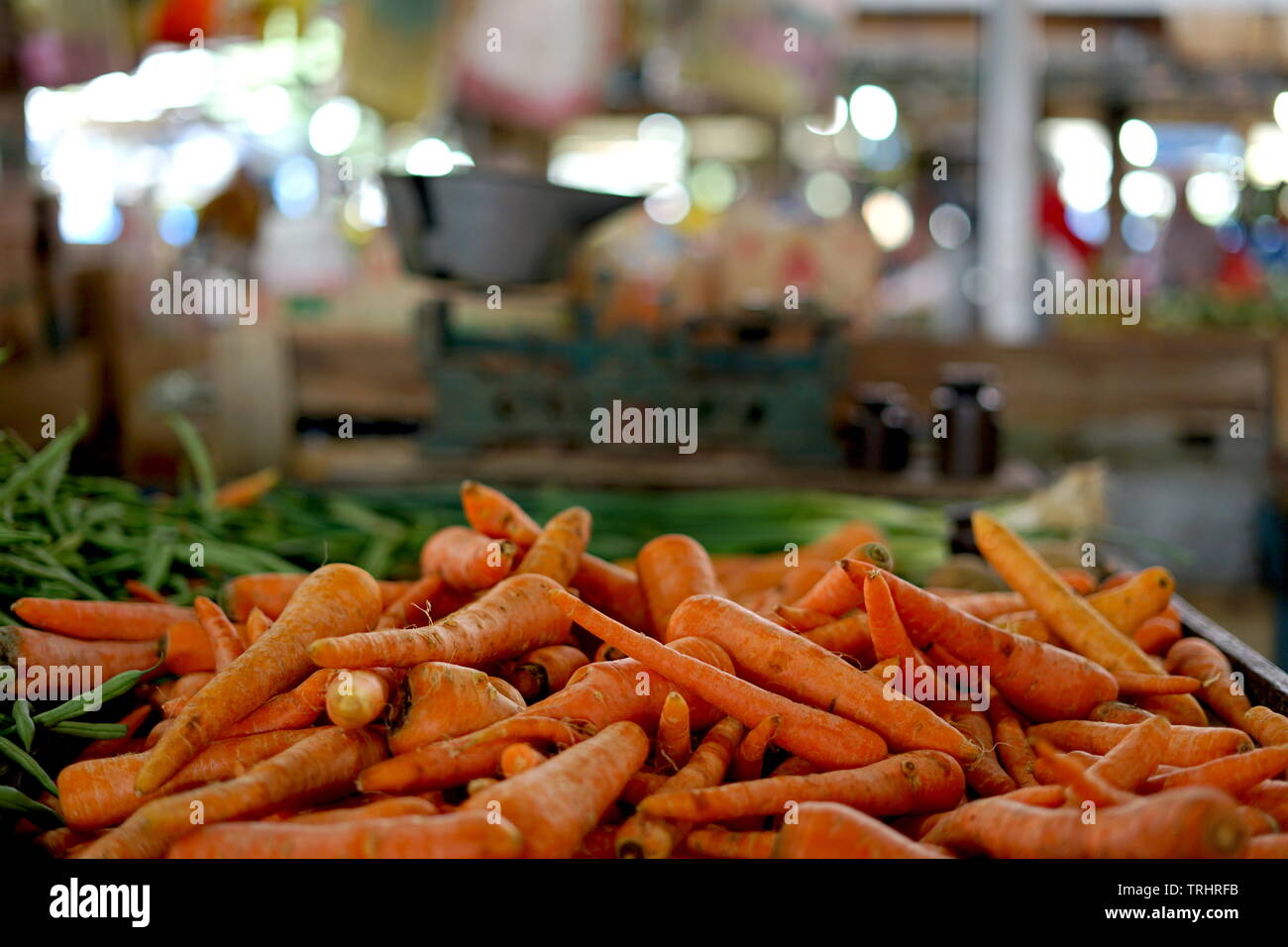 Fresh Carrots and old scales at Farmers' market - Stock Image