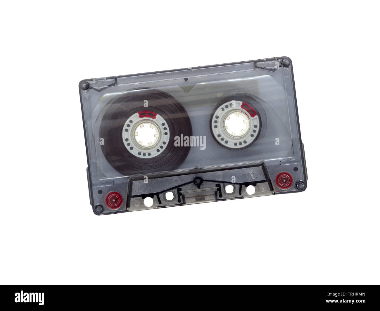 Transparent cassette tape (Compact Cassette, Compact Audio Cassette, Musicassette (MC)) isolate on white background - Stock Image