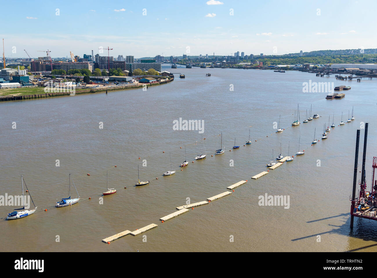 Aerial view of River Thames in eastern London with Thames Barrier in the background - Stock Image