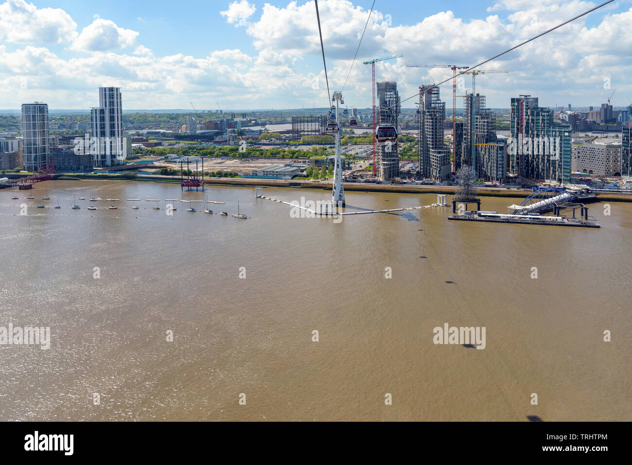 London, UK - May 1, 2018: Gondolas of Emirates Air Line arrive to station at Greenwich Peninsula in eastern London - Stock Image