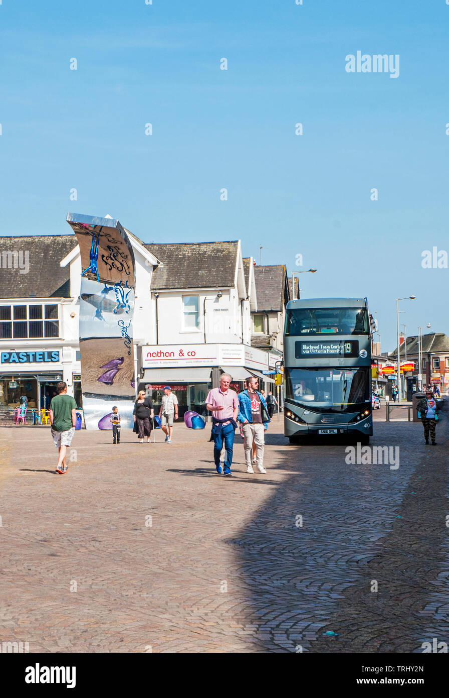 Blackpool Bus diverted through pedestrian precinct area after road closures in town centre due to laying new tramtrack - Stock Image