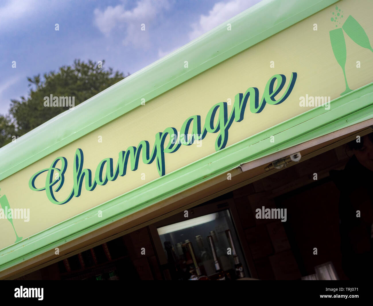 Champagne sign on mobile bar at outdoor event - Stock Image