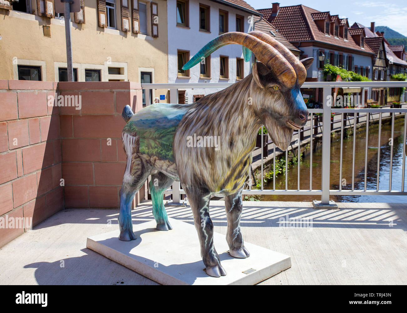 Ramgoat figure at the Queich stream, old town of Annweiler am Trifels, Rhineland-Palatinate, Germany - Stock Image