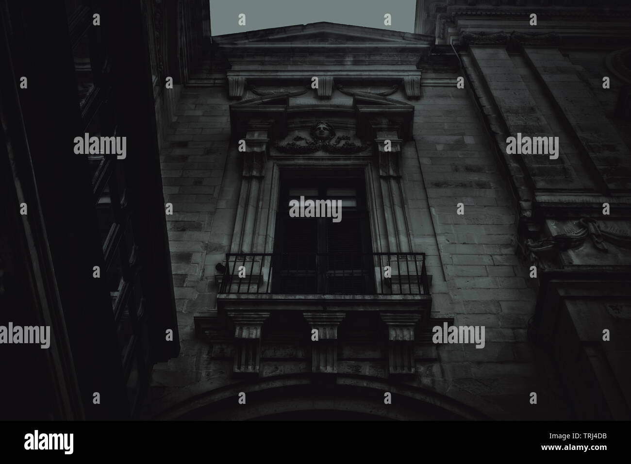 Spooky Buildings at Night in Malta. A vintage building in Valletta, Malta in black and white at night. - Stock Image