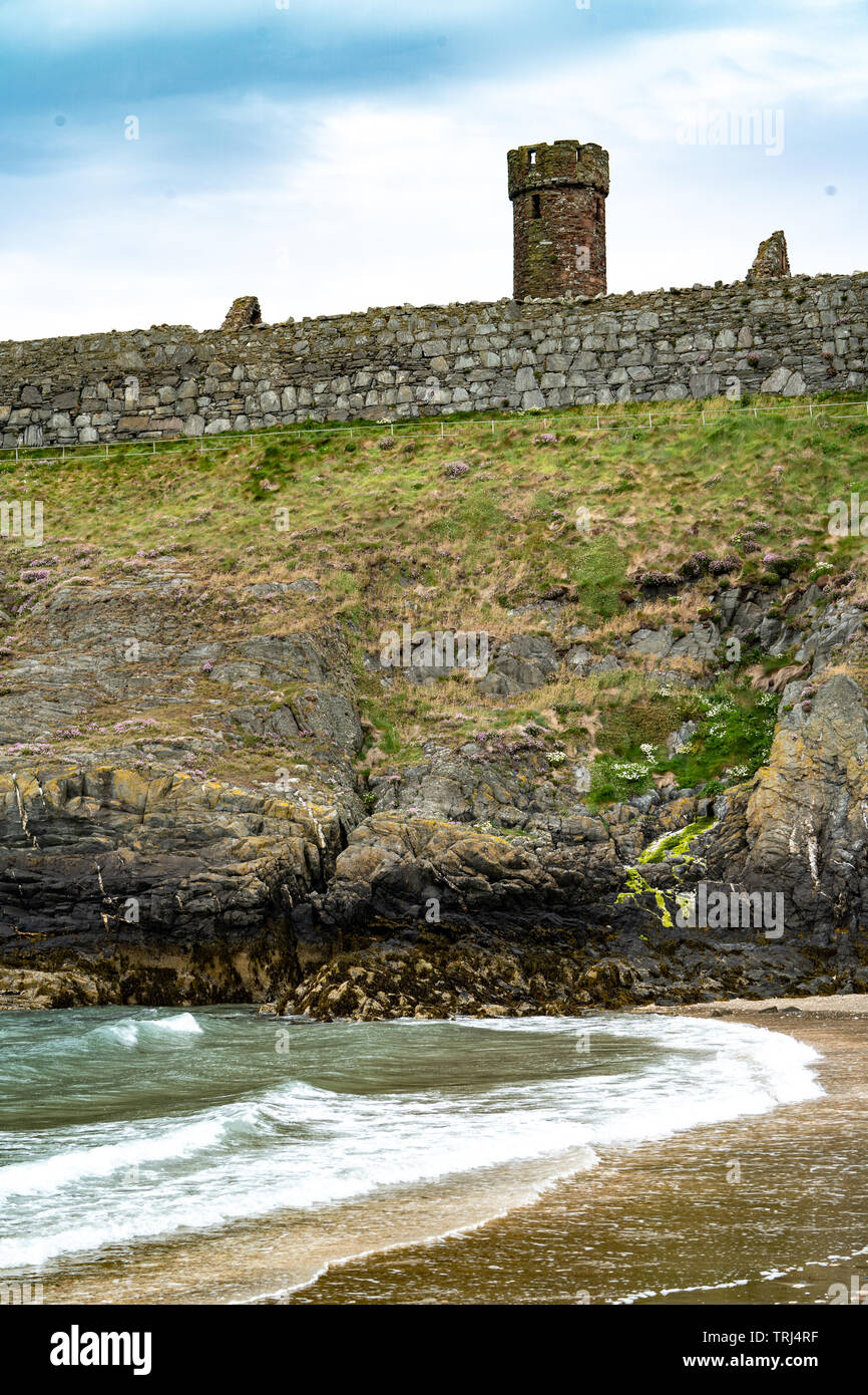 Round tower and 17th century curtain wall, Peel Castle, Isle of Man, UK - Stock Image