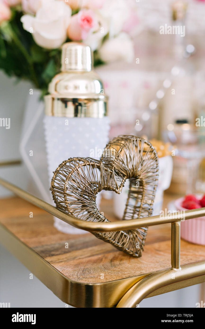 Close Up Of Gold And Wood Bar Cart Styled Romantically With Bouquet Of Roses White And Gold Cocktail Shaker Gold Heart Decor And Raspberries Stock Photo Alamy