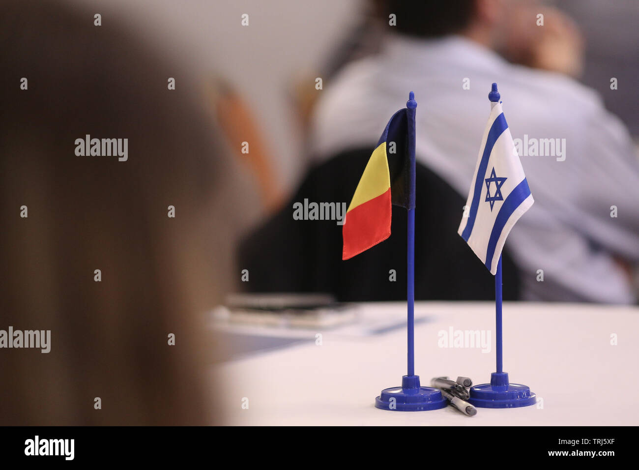 Romania and Israel flags one next to the other on a table. Israel-Romania bilateral relations. - Stock Image