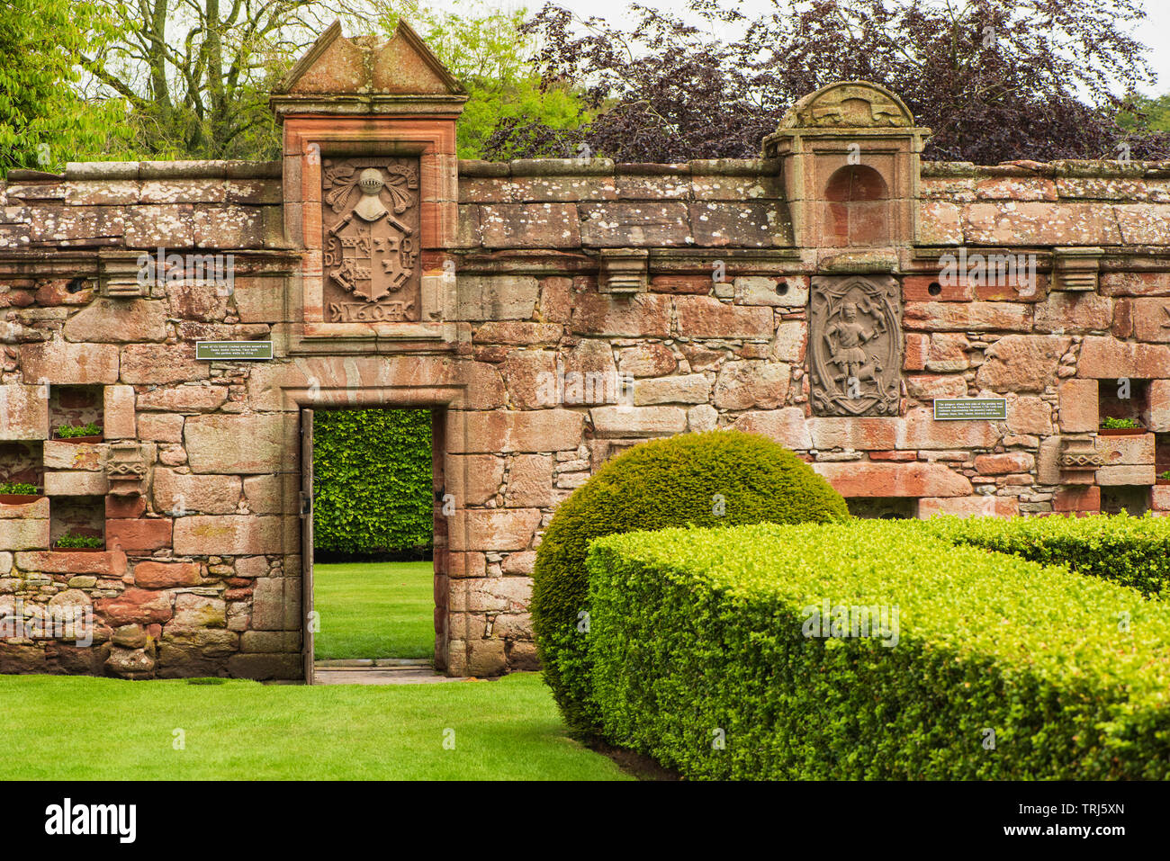Edzell Castle, Angus, Scotland. The elaborate walled garden was created in 1604. The Arms (above the garden door) of Sir David Lindsay and his second - Stock Image