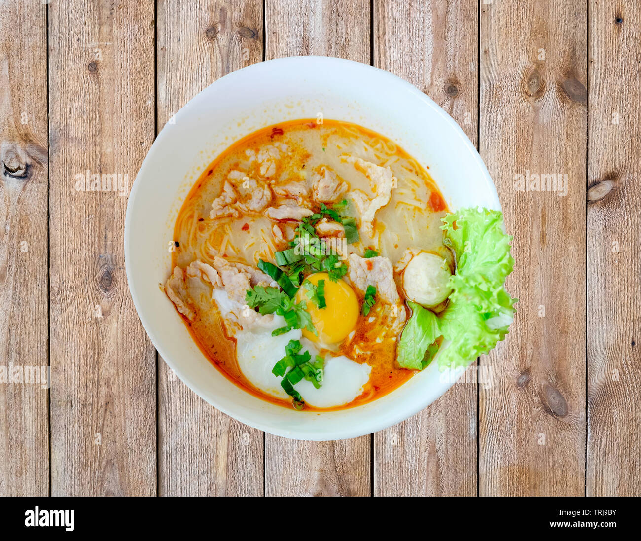 Noodle soup hot spicy pork egg and vegetable Stock Photo