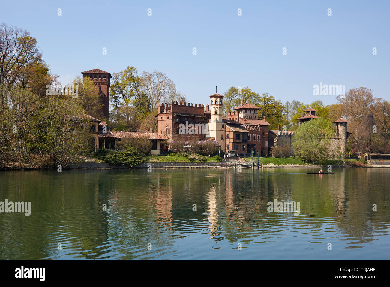 TURIN, ITALY - MARCH 31, 2019: Borgo medievale, medieval village and castle with Po river in a sunny day, man with canoe in Piedmont, Turin, Italy. Stock Photo