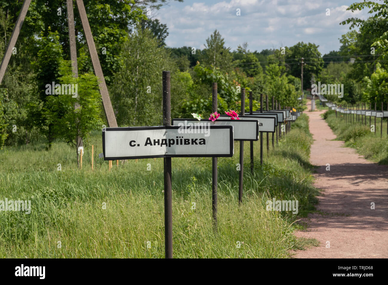 Signs with names of abandoned villages at the monument to the Chernobyl nuclear disaster , Chernobyl Exclusion Zone in Ukraine Stock Photo