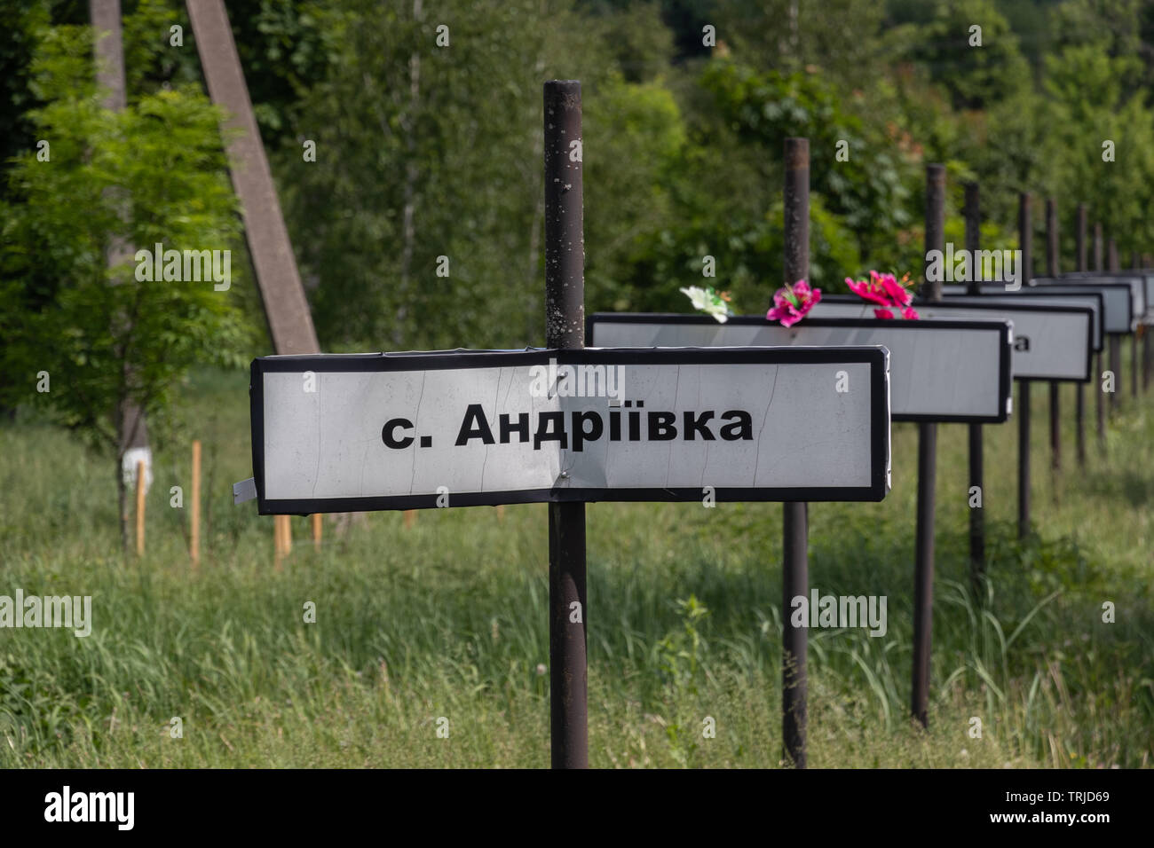 Signs with names of abandoned villages at the monument to the Chernobyl nuclear disaster , Chernobyl Exclusion Zone in Ukraine - Stock Image