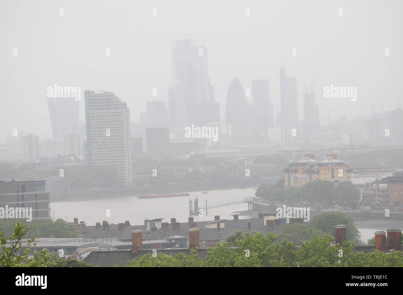 London, UK, 7 June 2019 .View over River Thames and City of London. Heavy rain over London in June.  Credit: Johnny Armstead/Alamy Live News - Stock Image