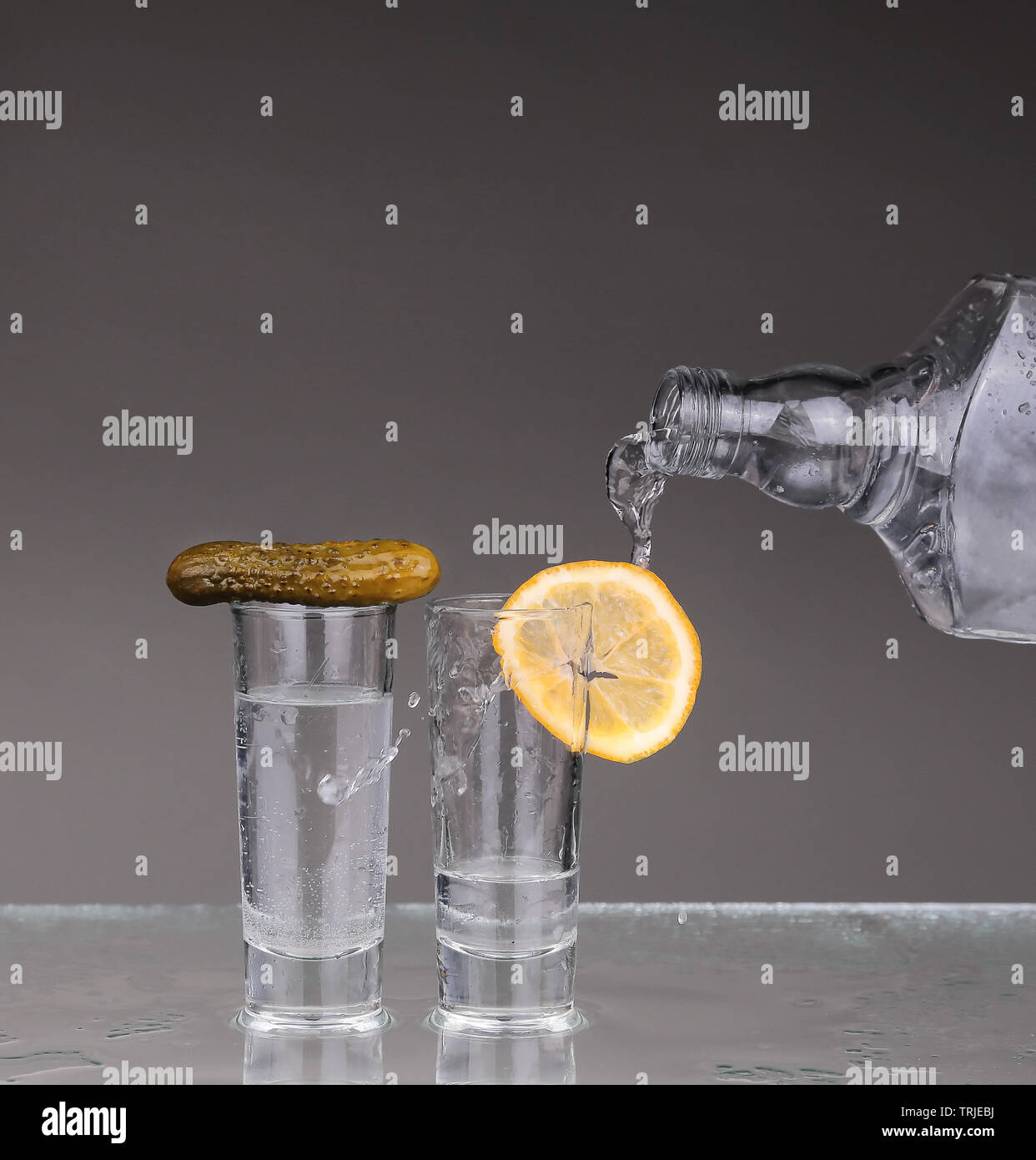 Vodka poured into a glass - Stock Image