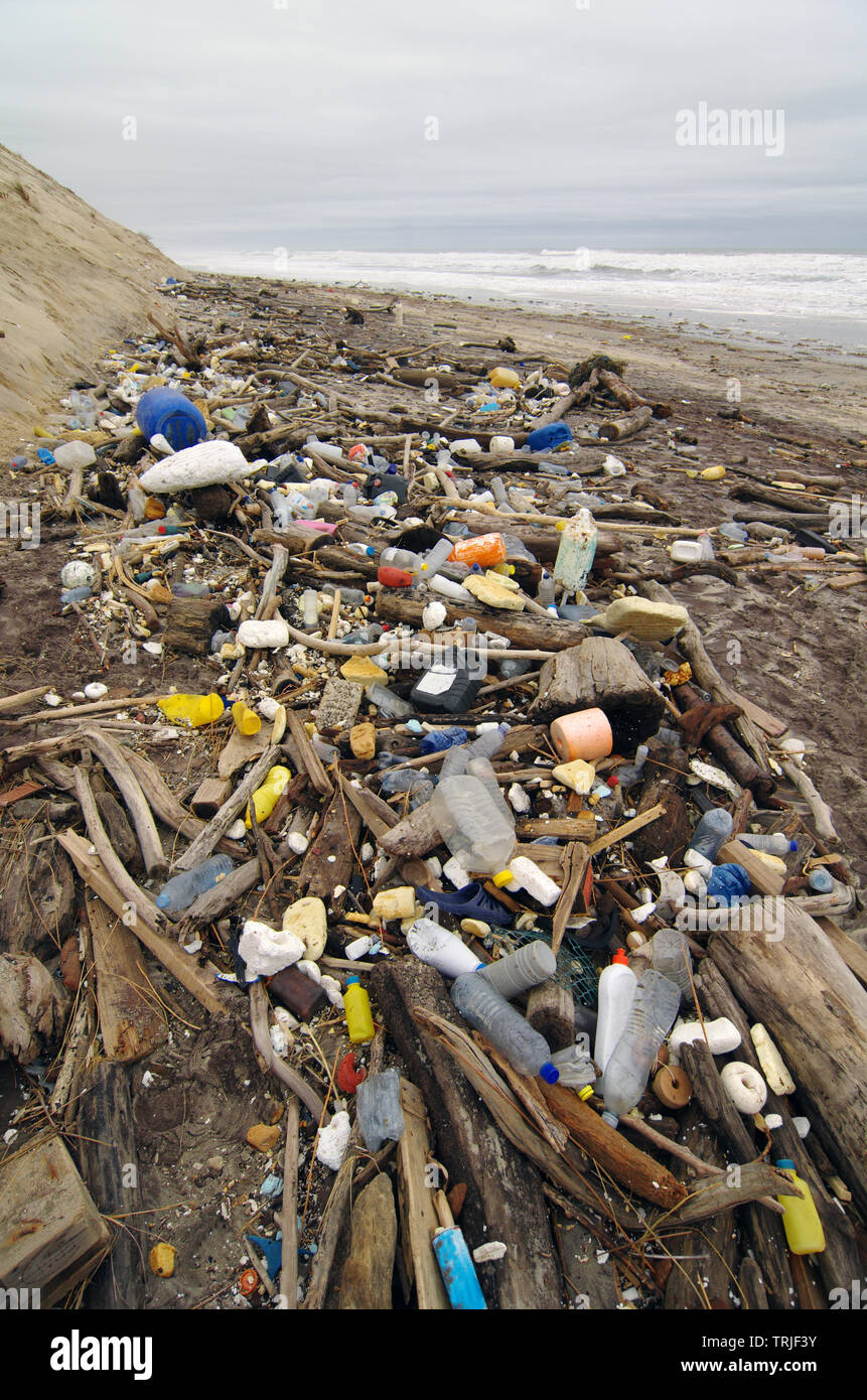 Trash beach pollution. Garbage, plastic, and wastes on the beach - Stock Image