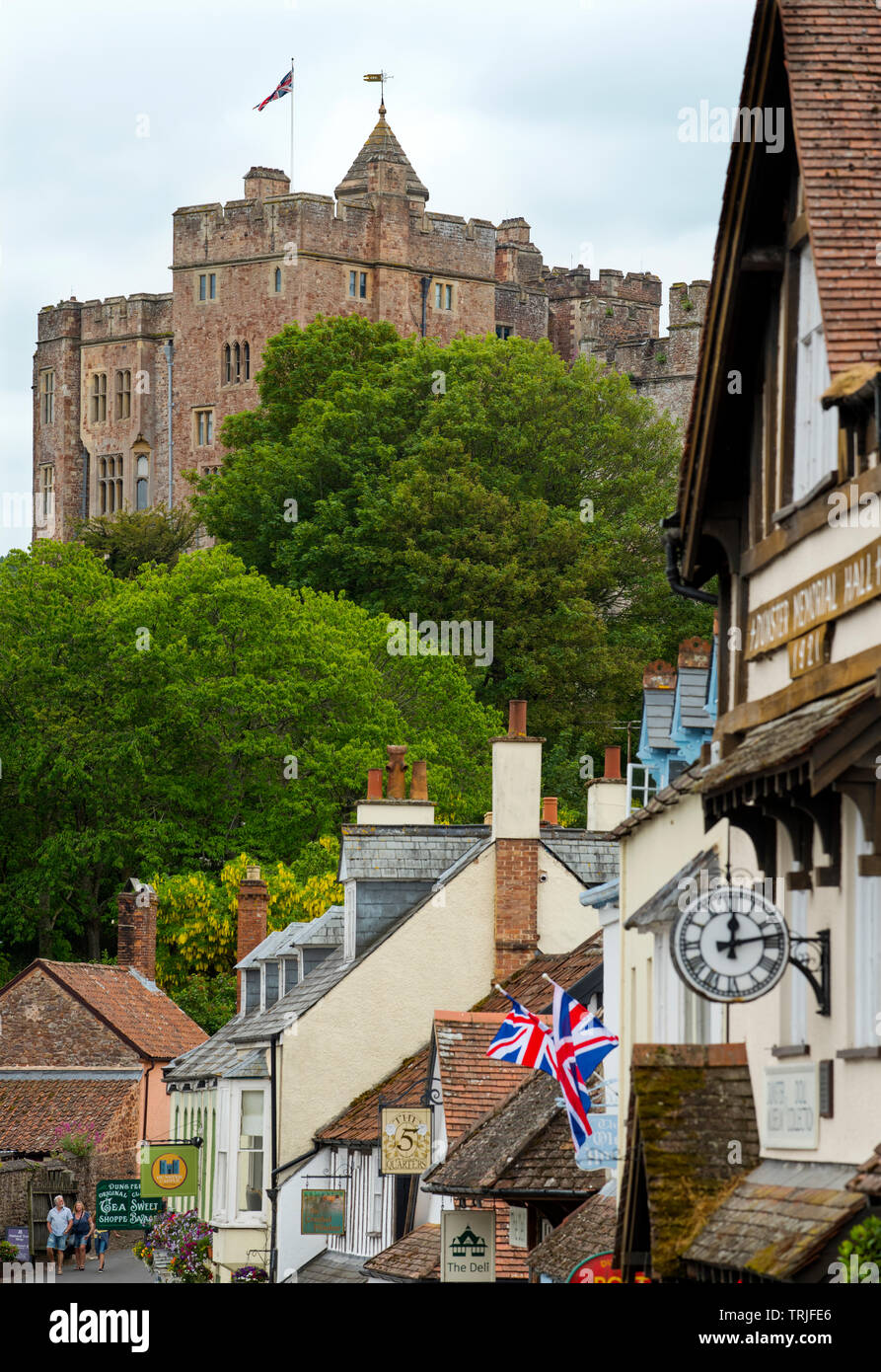 Dunster Exmoor Somerset England UK. May 2019 Showing Dinster Castle and Yarn Market Dunster is a village, civil parish and former manor within the Eng Stock Photo