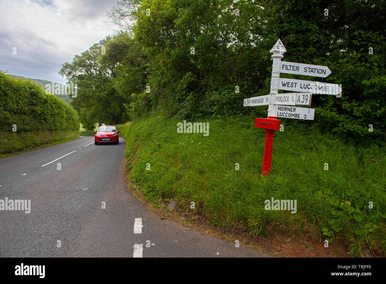 Exmoor Devon England UK. Road sign near Porlock. May 2019 Red Post or Finger Post sign post featured on modern Master Map Data. Stock Photo