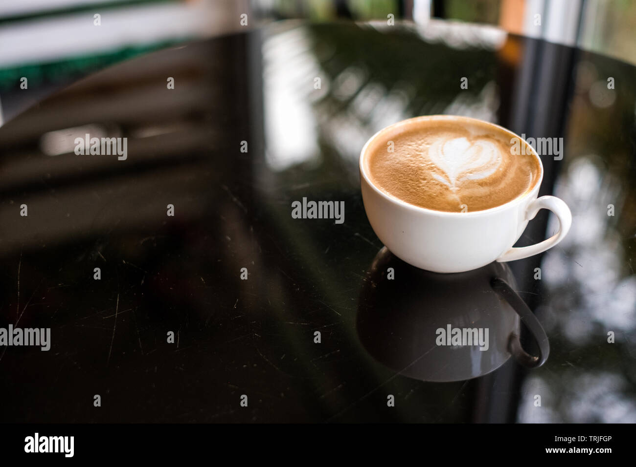 Coffee Latte Heart Shape In White Cup On Glass Table Stock Photo