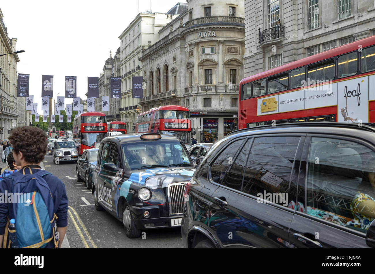 London, United Kingdom, 14 June 2018. London taxis, called cabs, are one of the symbols of the city. Classically of strictly black color. Sometimes wi - Stock Image