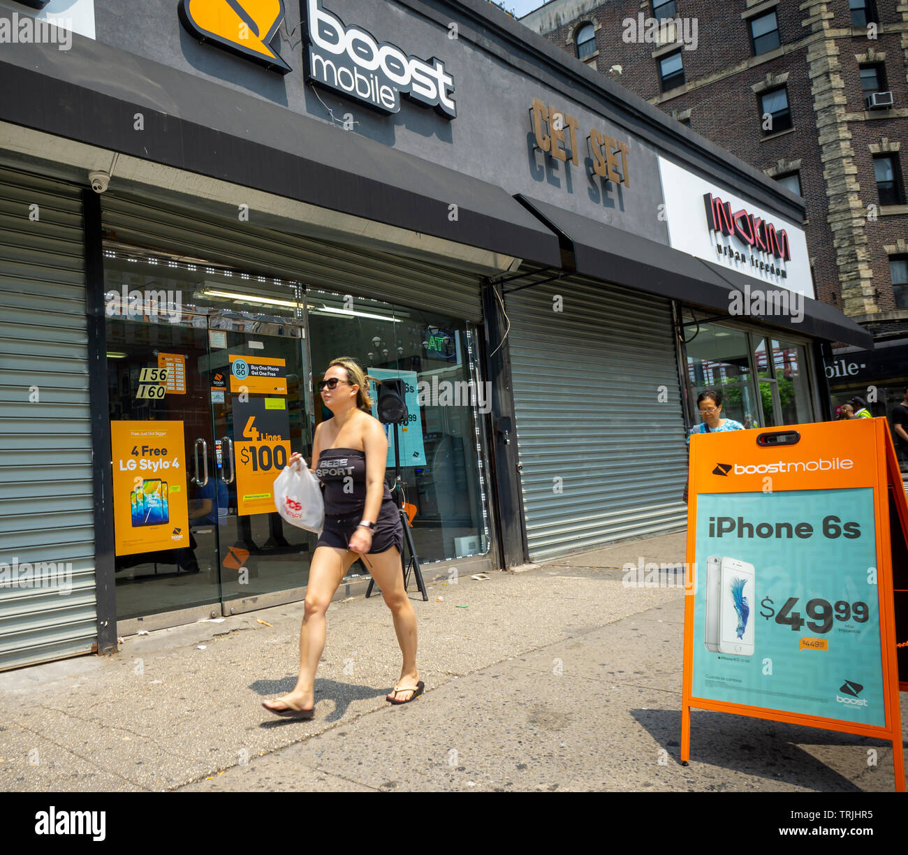 A Boost Mobile store in the Lower East Side neighborhood in New York on Sunday, June 2, 2019. Amazon is reported to be interested in purchasing Sprint's Boost Mobile prepaid wireless business due to concerns related to the T-Mobile and Sprint proposed merger. (© Richard B. Levine) - Stock Image