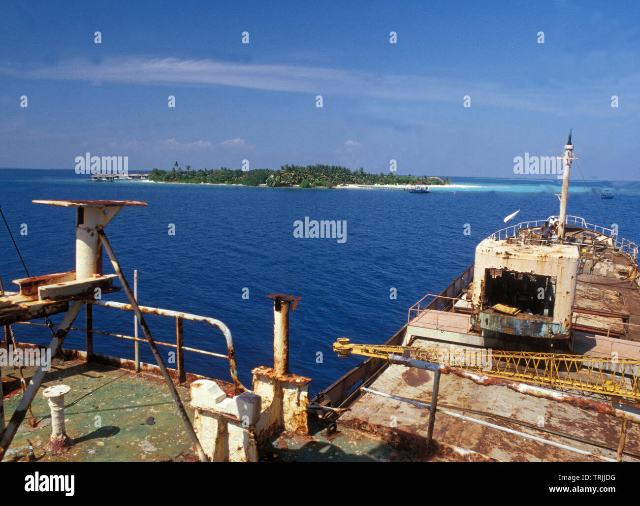 The freight wreckship Kudih Ma is carried to the tourist island and there to be sent to the bottom for e better submarine environment. - Stock Image