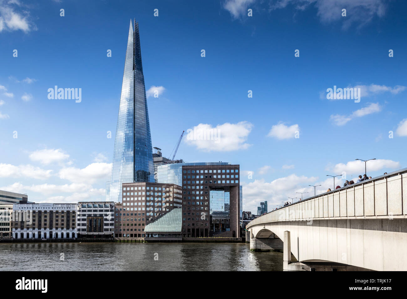 London Bridge, commuters and the Shard - Stock Image